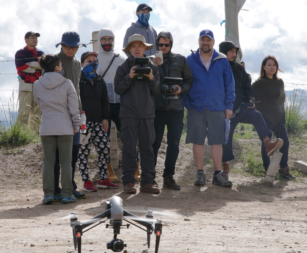 (Center) Evan Feng piloting the DJI drone